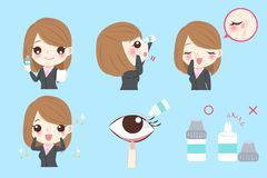 Businesswoman with eye drops. On the blue background Royalty Free Stock Photo