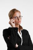 Businesswoman with eyeglasses. Young blond usinesswoman with eyeglasses Royalty Free Stock Photography