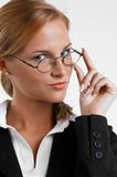 Businesswoman with eyeglasses. Young blond usinesswoman with eyeglasses Royalty Free Stock Image