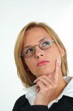 Businesswoman with eyeglasses. Young blond businesswoman with eyeglasses stock image