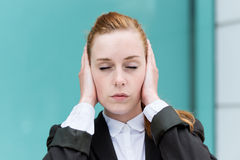 Businesswoman With Eyes Closed Covering Ears Stock Photos