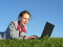Businesswoman face with notebook. On blue sky stock images