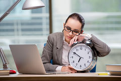 The businesswoman failing to meet challenging deadlines Stock Image