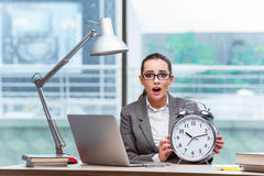 The businesswoman failing to meet her deadlines in business concept Royalty Free Stock Image