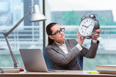 The businesswoman failing to meet her deadlines in business concept Royalty Free Stock Photography
