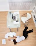 Businesswoman fainted on floor Royalty Free Stock Images