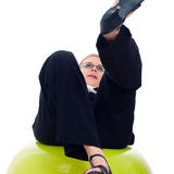 Businesswoman falling down from exercise ball Royalty Free Stock Image