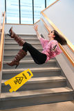 Businesswoman Falling on Stairs Stock Photos