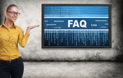 Businesswoman and FAQ message on a screen Stock Image
