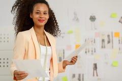 Businesswoman in fashion design atelier. Picture of young happy businesswoman in fashion design atelier Royalty Free Stock Photos
