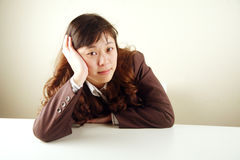 Businesswoman feeling tired Stock Photo