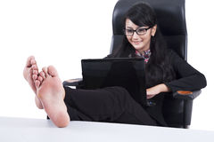 Businesswoman with Feet Up on a table Stock Image