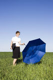 Businesswoman in the field with laptop Royalty Free Stock Photos