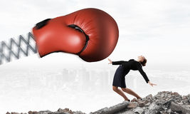 Businesswoman fighting with boxing glove Royalty Free Stock Photo