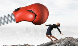 Businesswoman fighting with boxing glove Royalty Free Stock Image