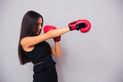 Businesswoman fighting in boxing gloves Stock Photography