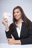 Businesswoman fighting about the money Stock Photo