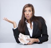 Businesswoman fighting about the money. Businesswoman Holding Money british pounds Royalty Free Stock Photo