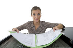 Businesswoman with file at filing cabinet, portrait, cut out Royalty Free Stock Photography