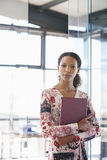 Businesswoman With File Folder In Office Royalty Free Stock Image