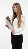 Businesswoman with file. Young businesswoman holding a large closed file, with a straight face. Isolated on white royalty free stock photo
