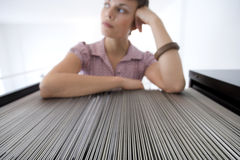 Businesswoman by filing cabinet Royalty Free Stock Images