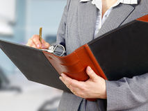 Businesswoman filling a form Royalty Free Stock Image