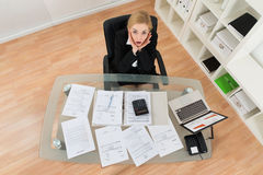 Businesswoman With Financial Bills Stock Photography