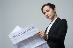 Businesswoman with financial newspaper Stock Photo