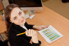 Businesswoman with financial report Royalty Free Stock Image