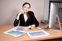 Businesswoman with financial report at office Stock Photography