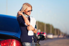 Fashion business woman with financial papers at the car Royalty Free Stock Photography
