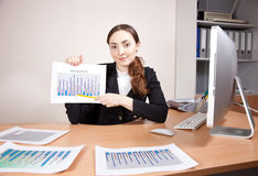 Businesswoman with financial reports Stock Photo