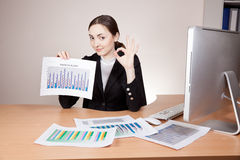 Businesswoman with financial reports Stock Images
