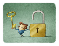 Businesswoman find a solution. Businesswoman with a key  in a hand and an opend padlock. It is a metaphor to find a solution or a security metaphor Stock Images