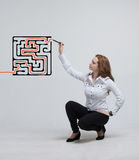 Businesswoman finding the maze solution writing on Stock Image