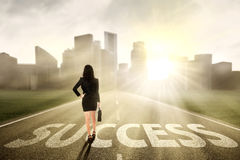Businesswoman finding the success way Stock Images