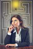 Businesswoman finds a good idea. Beautiful manager woman finally found the good idea  . Business and success concept Royalty Free Stock Photography
