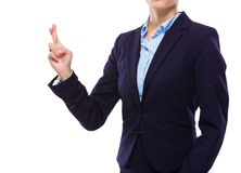 Businesswoman with finger crossed Stock Images