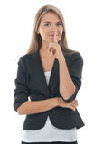 Businesswoman with finger on lips Stock Images