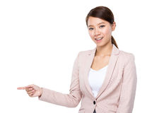 Businesswoman with finger point aside Royalty Free Stock Photos