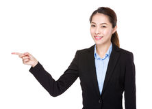 Businesswoman with finger point aside Royalty Free Stock Images