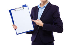 Businesswoman finger point to blank paper of clipboard Stock Photos