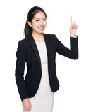 Businesswoman with finger point up stock image