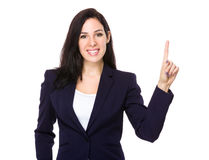 Businesswoman with finger point up Stock Images
