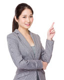 Businesswoman for finger point up selling something Stock Photo