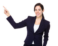 Businesswoman with finger point upwards Stock Photos