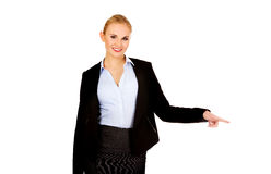 Businesswoman with finger pointing for copyspace or something Royalty Free Stock Photo