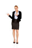 Businesswoman with finger pointing for copyspace or something Royalty Free Stock Images