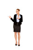 Businesswoman with finger pointing for copyspace or something Royalty Free Stock Image